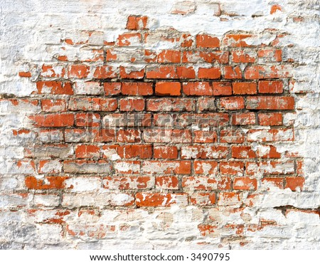 Fragment of old brick wall with white stucco - stock photo