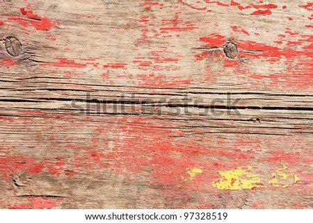 Fragment of old repeatedly painted boards with a shelled paint