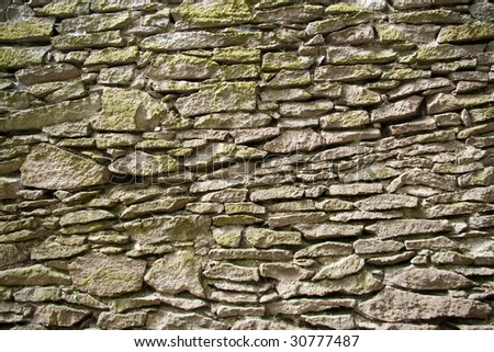 fragment of old stone wall surface texture