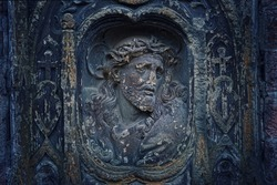 Fragment of old tombostone. Jesus Christ on dark stone background. passionate Friday. concept of religion, lent, dead, Faith in God
