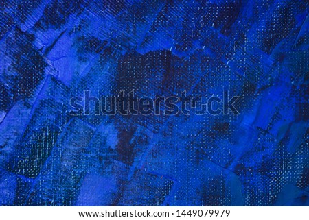 Fragment of painting artwork close-up. Large diagonal strokes of bright blue paint on a darker base.  Abstract composition. Modern Art.
