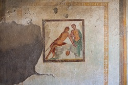 Fragment of painting on the remains of a wall in a courtyard in a ruined estate on the site of an archaeological site of the Roman city of Pompeii (destroyed in 79 BC by the eruption of Vesuvius).
