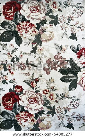 Fragment of retro tapestry fabric pattern with colorful  floral ornament on white background.