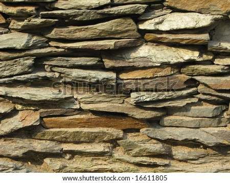 Fragment of rustic stone wall surface texture