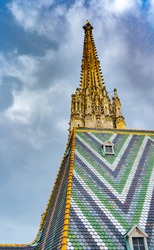 Fragment of Saint Stephen's Cathedral (Stephansdom). Colorful roof and tower. Wien. Vienna. Austria. Europe