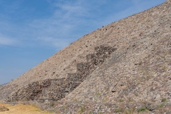 Fragment of sun pyramid in Teotihuacan. Structure of ancient stones. Travel photo, background, wallpaper, texture. Mexico.