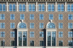 Fragment of Symmetric facade decoration in modern building