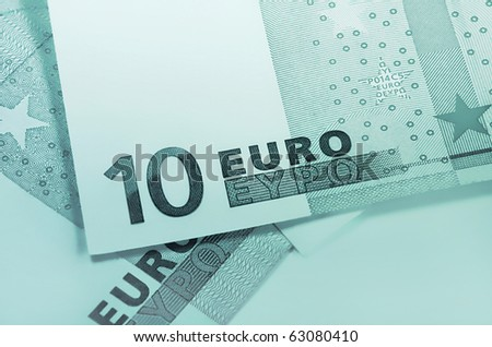 fragment of ten euro money, green abstract background