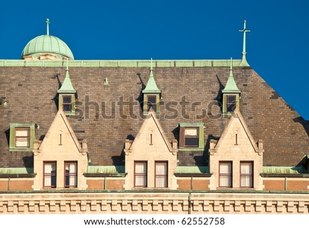 Fragment of the beautiful roof and windows of the historic empress hotel in Victoria, British Columbia.