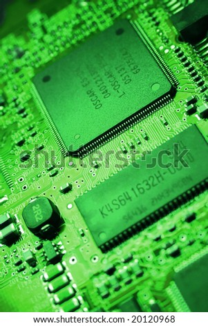 Fragment of the electronic circuit - green computer board with chips and components