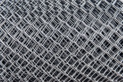 fragment of the fence netting in the roll