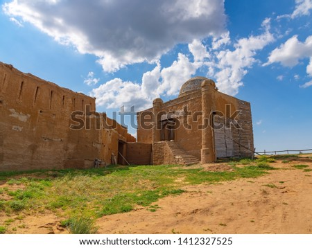 Fragment of the fortress wall and religious building of religious sense from the baked brick smeared with clay #1412327525
