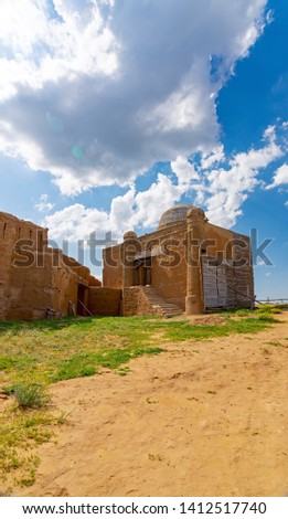 Fragment of the fortress wall and religious building of religious sense from the baked brick smeared with clay #1412517740