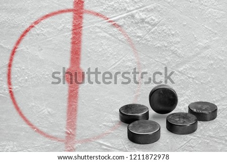 Fragment of the hockey arena with markings and washers. Concept, hockey