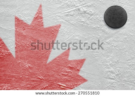 Fragment of the image of the Canadian flag on a hockey rink and puck