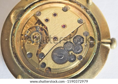 fragment of the mechanism of an old watch