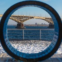 Fragment of the Saratov bridge across the Volga in a wooden circle