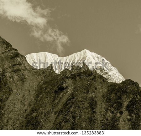 Fragment of the snow ridge in the massif of wall Nuptse from slope of the Kala Patthar - Everest region, Nepal, Himalayas (stylized retro)