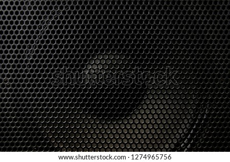 Fragment of the speaker with a metal perforated grille. Great background for advertising and design #1274965756