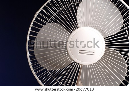 Fragment of the white fan on a black background