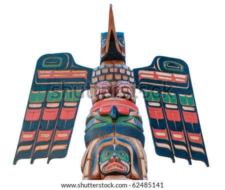 Fragment of totem pole in Vancouver, Canada. Isolated on white.