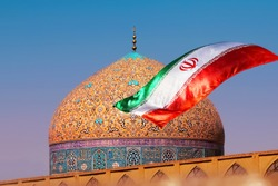Fragment of traditional Iranian architecture and Iran's national flag.
