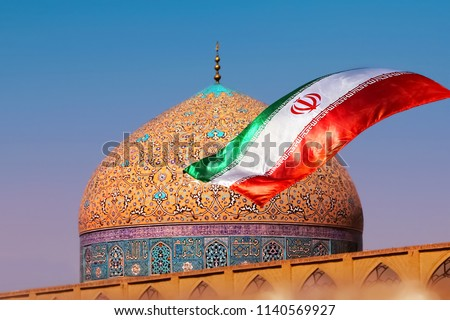 Fragment of traditional Iranian architecture and Iran's national flag.  #1140569927