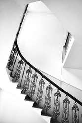 Fragment of vintage internal staircase in Grodno, Belarus. Black and white architectural composition.
