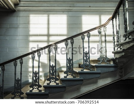 Fragment Of Vintage Metal Fence Of Internal Staircase. Ornate Handrail Of  Wrought Iron. Stone