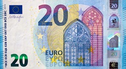 Fragment part of 20 euro banknote close up with small blue details