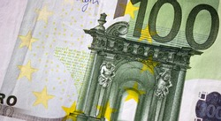 Fragment part of 100 euro banknote close up with small green details