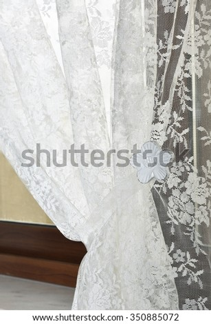 Fragment photo curtain, interior detail, curtain detail close up, white curtain, decor, decor of room, apartment. Curtain detail close up. Room interior #350885072
