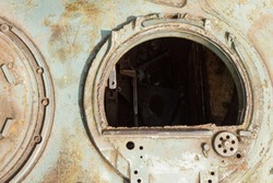 Fragment  tower of an old tank. Open tank hatch. Details of the old Soviet tank.   Military green camouflage metal background