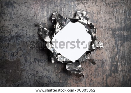 Fragmentary aperture on a metal plate - stock photo