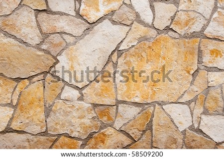 Fragmented stone wall texture - stock photo