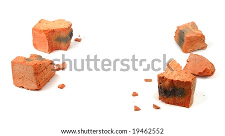 Fragments of shattered brick isolated over white