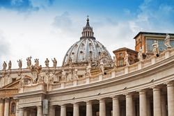 Fragments of the Papal Basilica of St. Peter in the Vatican and columns on Saint Peter`s square in Vatican
