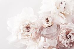 Fragrance bottle as luxury perfume product on background of peony flowers, parfum ad and beauty branding design