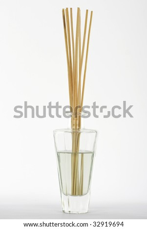 fragrance reed diffuser on white background