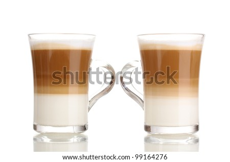 Fragrant coffee latte in glass cups isolated on white