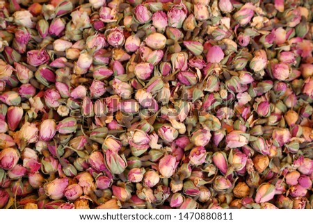 Fragrant dried Moroccan roses in a seasonal market. They are used for making perfume essences, in potpourris (aromatic mixtures) as well as for aromatization of teas, pastries and poultry dishes.