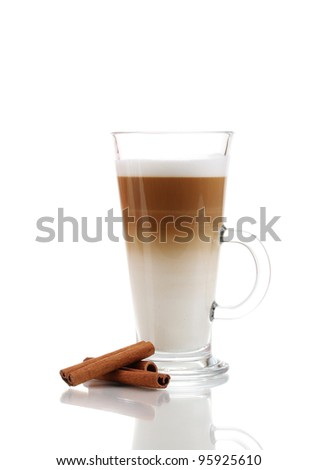 Fragrant ?offee latte in glass cup and cinnamon isolated on white
