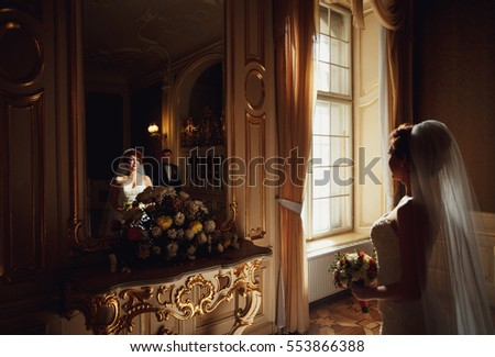 frail woman in a wedding dress went to the mirror