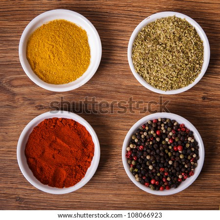 Frame composition of spices on wood, anise,cinnamon,pepper, laurel