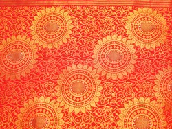 Frame filling closeup view of Banares silk sari. These exquisite, expensive sarees are famous for their gold and silver zari, brocade.