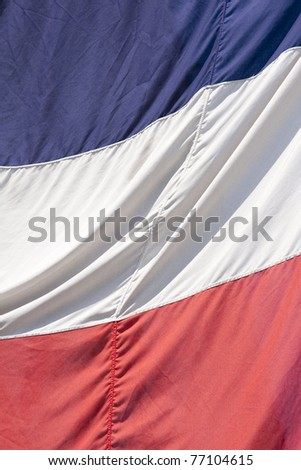 Frame filling shot of the French flag on a bright and sunny day
