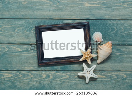 Frame for a photo in a marine style on wooden background