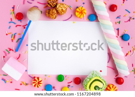 Frame for the text on the background of different, sugar, children's sweets. Candies on a pink background. Copy space, sweets concept Stockfoto ©