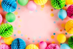 Frame from Balloons and confetti on pink background. Valentines day, Birthday, holiday concept. Flat lay, top view. Birthday party background