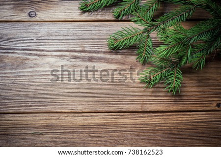 Frame from branch of Christmas tree on old wood #738162523